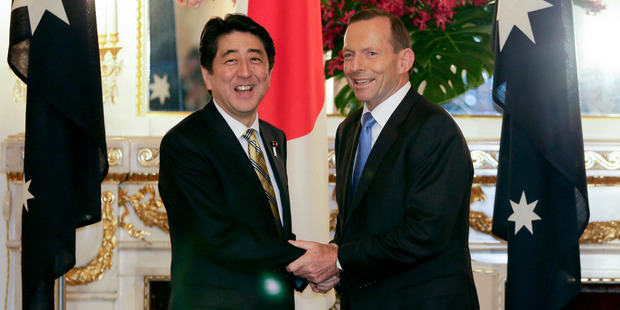 Japan's PM Shinzo Abe and Tony Abbott have concluded a trade deal that some purists have poured scorn on. Photo / AP