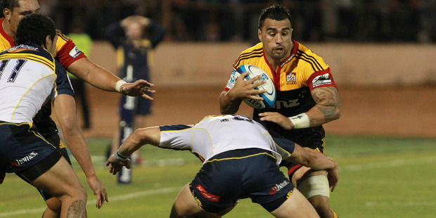 Liam Messam of the Chiefs looks for a way around Brumbies' Andrew Smith in a previous Chiefs vs. Brumbies clash.