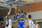 CRASHING GLASS: Hawks import Kareem Johnson (left), point guard Jarrod Kenny and shooting guard Everard Bartlett watch as Nuggets import Warren Carter anticipates a rebound. PHOTO/Otago Daily Times