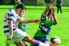 MAC fullback Tianua Poto avoids a charge-down from NOBM halfback Corey Simpkins  with a clearance during Saturday's game at Flaxmere Park. NOBM flanker Sean Watts awaits the outcome. Photo/Warren Buckland
