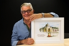 David Foley with a copy of his painting of Tyne Cot Cemetery in Belgium. Photo / John Stone