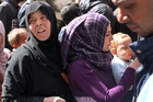 Residents of the besieged Palestinian camp of Yarmouk in Damascus queue in February for UN aid. Photo / AP