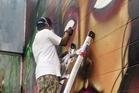 A street artist at work in Kaka'ako. Photo / Heather McCracken