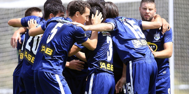 Auckland City players celebrate against Waitakere United earlier this season. Photo / Shane Wenzlick