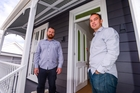 Justin Boyes (left), marketing manager for HRV and Ben Harvey-lovell, marketing manager for Mercury Energy on the deck of a house renovation project. Photo / Jason Dorday