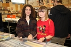 Real Groovy customers Millie Ketchley, left, and Isabelle Livingstone say music sounds better on vinyl. Photo / Peter Calder