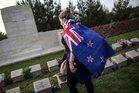 A woman visits graves in Gallipoli, Turkey, where thousands of Australians and New Zealanders died in World War I. Photo / AP