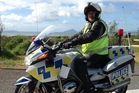 Constable Andy Williams from Waitemata Police helped his Northland colleagues on State Highway 1 near Uretiti over the Easter weekend. Photo/Supplied