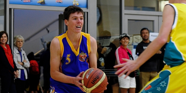 Finn Russel in possession for Tauranga Under-17 Boys v Australian Country Cup in yesterday's final at ASB Arena. Photo/George Novak