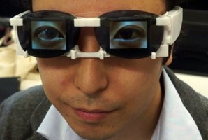 Hirotaka Osawa shows the AgencyGlass, a device to project emotions.  Photo / AFP