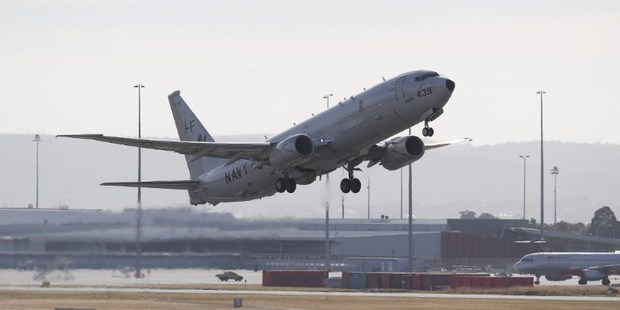 April 17 photo of US Navy P8 Poseidon taking off from Perth International Airport en route to the search for MH370. Photo / AFP
