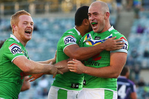 Joel Edwards, Bill Tupou, and Terry Campese embrace after winning the round seven NRL match between the Canberra Raiders and the Melbourne Storm. Photo / Getty Images