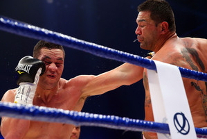 Kiwi Joseph Parker (left) knocked Marcelo Nascimento to the canvas in the  opening round Picture / Getty Images