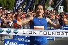 Masataka Uchino from Japan crosses the finish line at the Rotorua Marathon. Photo / Macspeed