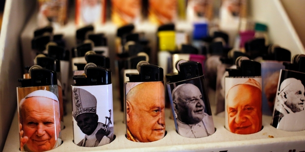 Images of St John Paul II and St John XXIII are on sale near the Vatican. Photo / AP