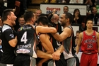 CELEBRATIONS: The Hawks erupt at the final buzzer. The Rams player's face says it all. PHOTO/Duncan Brown