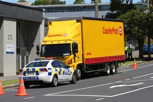 The CourierPost truck that injured a woman as it backed her into a wall. Photo / Chris Loufte