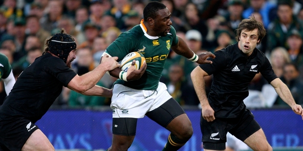All Blacks Andrew Hore, left, and Conrad Smith, right, tackle South Africa's Tendai Mtawarira in 2009. Photo / AP