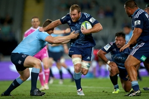 Luke Braid tackled by the Waratahs' Dave Dennis. Photo / Getty Images