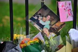 Floral tributes and a picture of murdered Spanish teacher Ann Maguire outside Corpus Christi Catholic College. Photo / AFP
