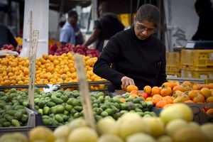 Selecting the best produce at Avondale's popular market.