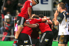 Crusaders team mates celebrate after scoring a try during the round 12 Super Rugby match between the Crusaders and the Brumbies at AMI Stadium. Photo / Getty Images.