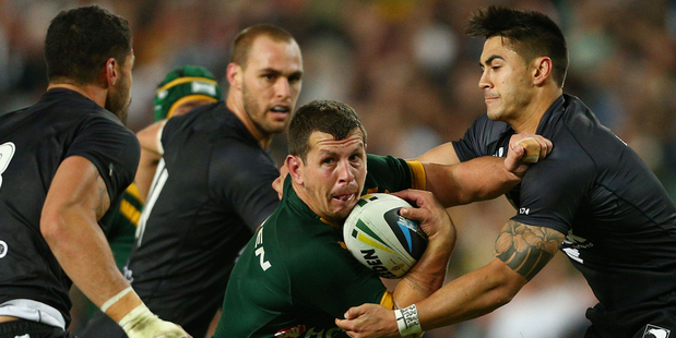 Greg Bird of Australia is tackled by Simon Mannering and Shaun Johnson during the ANZAC Test match between the Australian Kangaroos and the New Zealand Kiwis. Photo / Getty Images.