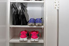 With this adjustable rack, there's no excuse not to put away your shoes. Photo / Michael Craig