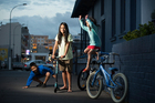 Jonathan Siah, 8,  and his  sisters Angeline, 12, and Elizabeth, 7, turn the carpark outside their apartment into a playground each evening. Photo / Greg Bowker