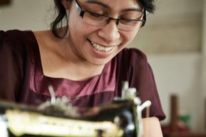 Ibu Gusti, a seamstress at Komang's Bali workshop. Photo / Dan Max. Styling / Laura Blade