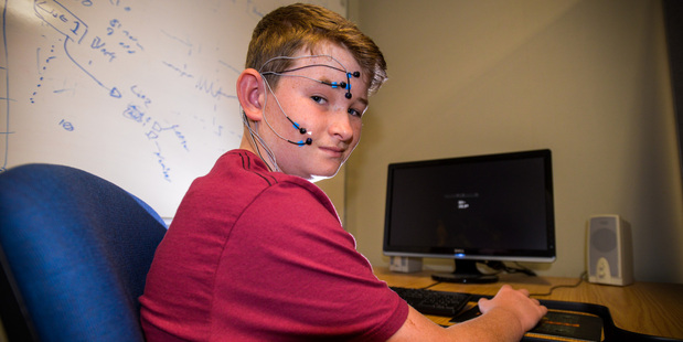 Elliott Fletcher, 12, is helping Sam Payne with his study into video games and possible links to aggression in the real world. Photo / Jason Dorday