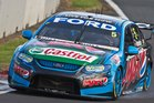 Mark Winterbottom from Ford Pepsi Max Racing winds up his Ford along the main straight during Race 13 of the ITM V8 Supercars at Pukekohe Park. Photo / Greg Bowker