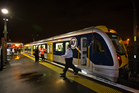 One of Auckland's electric trains arrives for its first trip from Onehunga to Britomart Train station. Photo / Greg Bowker