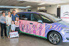 Elia Inglis 6.5yo from Greenhithe Primary kindly won her parents a month's use of a Citroen Grand Picasso by drawing a picture, which is now adorning the car. Photo / Supplied