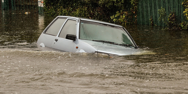 Four times in little more than a month, heavy rain has turned the land into a lake, flooding their homes, forcing them out. File photo / Getty Images