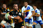 Tom Marshall of the Chiefs runs the ball during the round five Super Rugby match between the Chiefs and the Stormers at Waikato Stadium. Photo / Getty Images.
