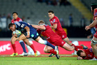 Bryn Hall of the Blues breaks the tackle of James Slipper of the Reds during the round 12 Super Rugby match between the Blues and the Reds at Eden Park. Photo / Getty.