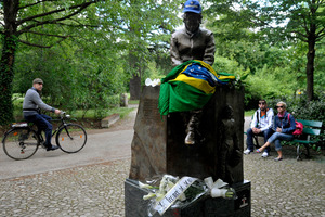A Brazilian flag and flowers adorn a statue of Ayrton Senna, in a park close to the Imola track, Italy. Picture/AP
