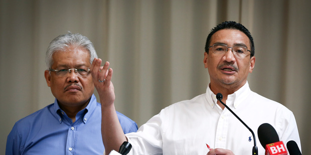 April 19 file photo, Malaysian Deputy Minister of Foreign Affairs Hamzah Zainudin, left, listening to acting Transport Minister Hishammuddin Hussein at a briefing. Photo / AP