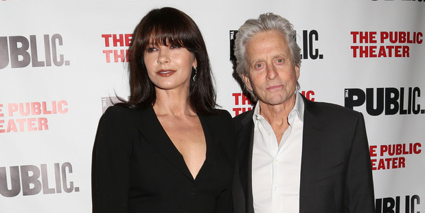 Catherine Zeta-Jones and Michael Douglas marriage 'break' last year was rumored to be down to her struggles with bipolar, rather than his battle with throat cancer. Photo / AP