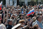 People wave Russian flags during a pro-Russia rally at Lenin square, Donetsk, Ukraine. Photo / AP