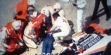 Rescue crew members give first aid to unconscious formula one driver Ayrton Senna, lying mortally injured, beside his wrecked car after the crash at the Italian Imola track. Photo / AP