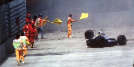 Race officials run towards Senna's car after he crashed 20 years ago (above). Pictures/AP