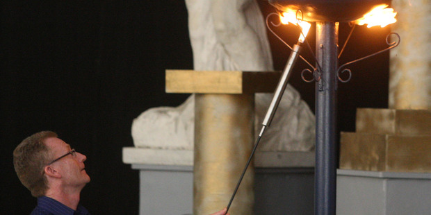 Games manager Mike Cronin lights the torch to open the 2013 NZ Masters Games. Photo/Bevan Conley