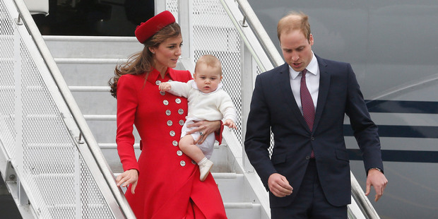 The Duke and Duchess of Cambridge with Prince George disembarking from the RNZAF jet after arriving at Wellington Airport. Photo / Mark Mitchell