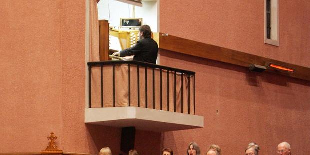 Organist John Wells.