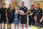 HBT140876-08 Grace Ropitini and Adam Ropitini 2 weeks old with players from the Hurricanes Super Rugby squad during a visit to the Hawke's Bay Hospital Children's Ward. Photograph: Glenn Taylor