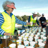 Judi Schnell from Havelock North Rotary Club provides drinks for thirsty runners and walkers.