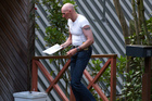 Stephen James at the Mt Pleasant property, checking Denis O'Rourke's mailbox. Photo / Martin Hunter