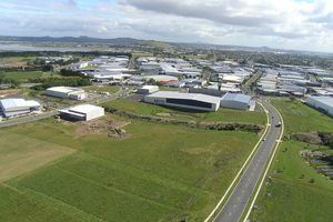 Rare vacant land at Manukau with encroaching industrial buildings.